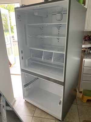 LG FRIDGE NEED GONE. NOT COOLING OFFERS ACCEPTED for Sale in Frederick, MD
