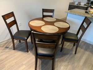 Brand new dining table with 4 comfortable chairs. Excellent Deal. Must Go. Moving out of state! for Sale in Dunedin, FL