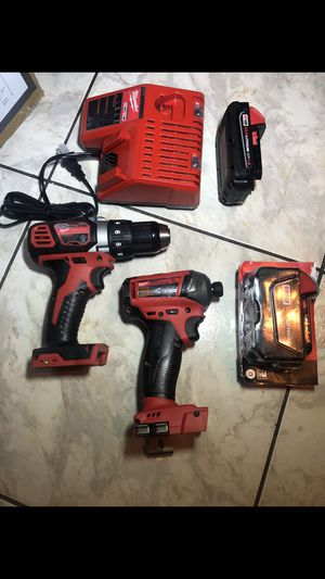 New Milwaukee 18 V drill set impact gun is fuel brushless but the drill is not brushless or hammer comes with two battery 1/5.0 and 1/1.5 plus charge for Sale in Lauderdale Lakes, FL