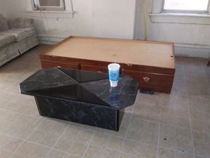 Free a twin bed with drawers an dogkennel an coffee table. Cabinet in good shape for Sale in St. Louis, MO