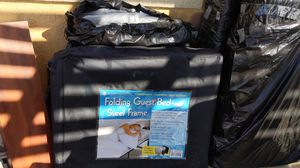 Folding guest bed with steel frame stores and on bag for Sale in Bonita, CA