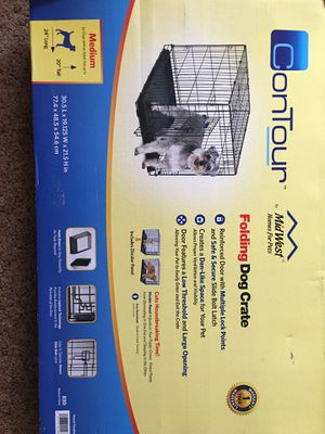 Dog cage medium with an adult size up 20 for Sale in Lincoln, NE