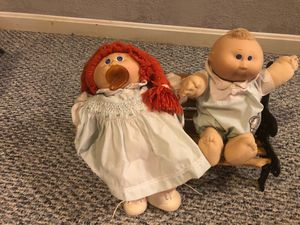 2 original vintage Cabbage Patch dolls sitting on a park bench great condition never played with for Sale in Herndon, VA
