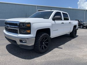 2014 Chevy Silverado full-size four-door 4 x 4 lifted on rims and tires for Sale in Tampa, FL