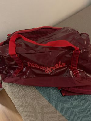 Brand new 70L blackhole duffel bag red brand new with tags retails at $159 before tax. for Sale in Huntington Beach, CA