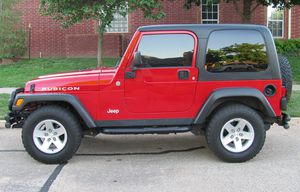 Red 2004 WRANGLER JEEP 4X4 AWDWheels Good for Sale in St. Louis, MO