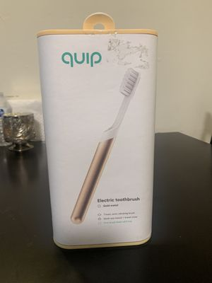 Gold quip electric toothbrush for Sale in Ontario, CA