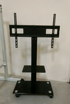 Brand new in box TV stand on wheels universal fits 32 to 65 Inch TV sizes flat screen LCD plasma for Sale in Pico Rivera, CA