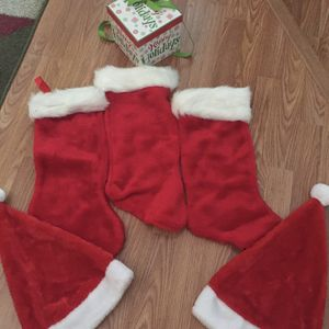 3 Christmas stockings, 2 Christmas hats and a Christmas gift box. All in excellent condition. for Sale in Hollywood, FL
