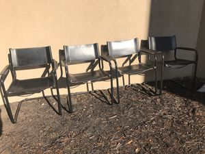 Leather dining chairs. Set of 4. Black hard lather with black metal tubular frame. Great condition. $200 set for Sale in Landrum, SC