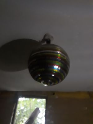 Large mirror ball.red green gold and blue for Sale in Huber, GA