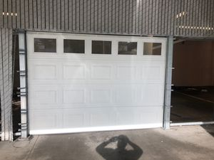 Garage door 10 foot wide 8 foot tall for Sale in Tacoma, WA