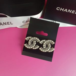 New CC Silver Plated surrounds diamonds Stud earrings 925 silver for Sale in Moreno Valley, CA
