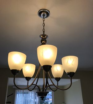 5-light Chandelier, brushed nickel, works as seen in the pic. Have extra one that I don't need, FREE 5 energy light bulbs with this light. for Sale in Charlotte, NC