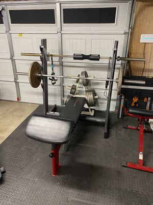 Weider Pro Weight Bench (Squat Rack) / Plate rack (No Weights) / Olympic curl bar for Sale in Rancho Cucamonga, CA