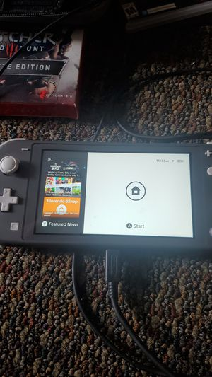 Grey Switch lite, charger, carrying case, the Witcher and Bioshock(the collection) for Sale in Anaheim, CA