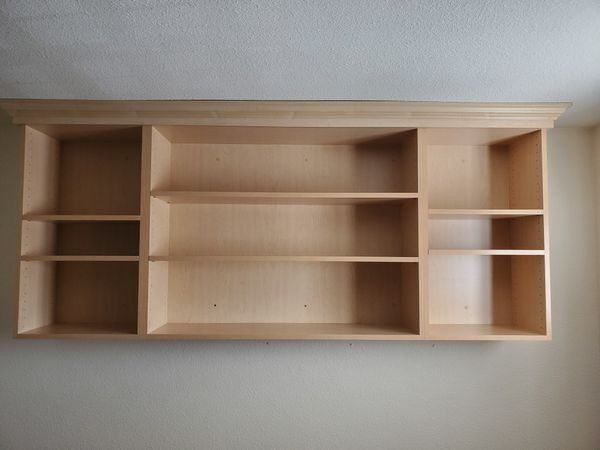 Laminated wood shelves with crown molding