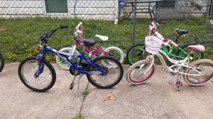 Kids bike for sale the small pink one Schwinn bike the girls bike is a swim two boys bike one is a rally the blue one the green one is a Kent for Sale in Camden, NJ