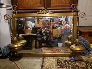Antique brass mirror from the 1800's with attached oil lamps for Sale in Bend, OR