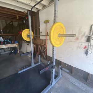 **Assembled ** Sunny Health & Fitness Power and Squat Rack with High Weight Capacity, Olympic Weight Plate Storage and 360° Swivel for Sale in Richmond, CA