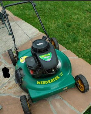 Weedeater brand push mower And Featherlight 4 String Curve Shaft Weed Eater for Sale in Lexington, KY