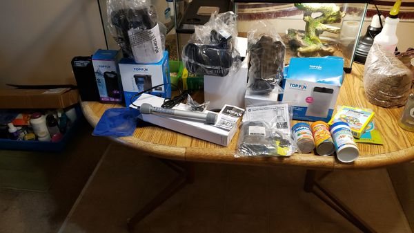 Top fin aquarium 5 new filters and heater some nets and food all $30.00