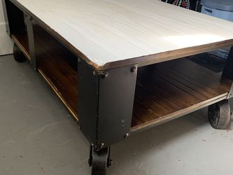 Rustic Coffee Table With Industrial Metal Wheels for Sale in Denver,  CO