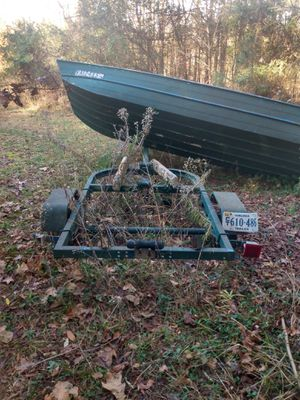 14 foot jon boat trailer (with boat if you want it) WITH CLEAN TITLE. for Sale in Chesterfield, VA