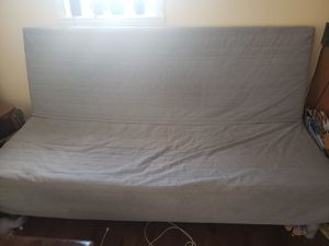 IKEA futon 7 feet long with cover and pillows for Sale in St. Louis, MO