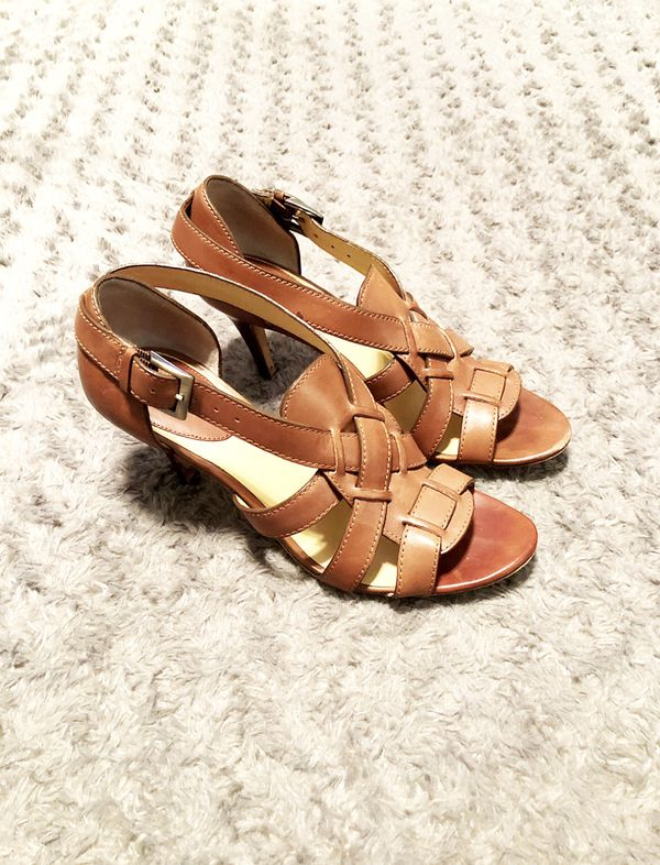 Cole Haan Strappy heels paid $240 size 6.5 Brown Leather Strappy Brown heels. Adjustable ankle straps, wooden heel height about 3.75.