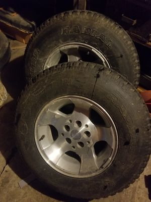 Aluminum Jeep wheels and Good Year Wranglers 235/75R15 Tires have about 75% tread for Sale in Alhambra, IL