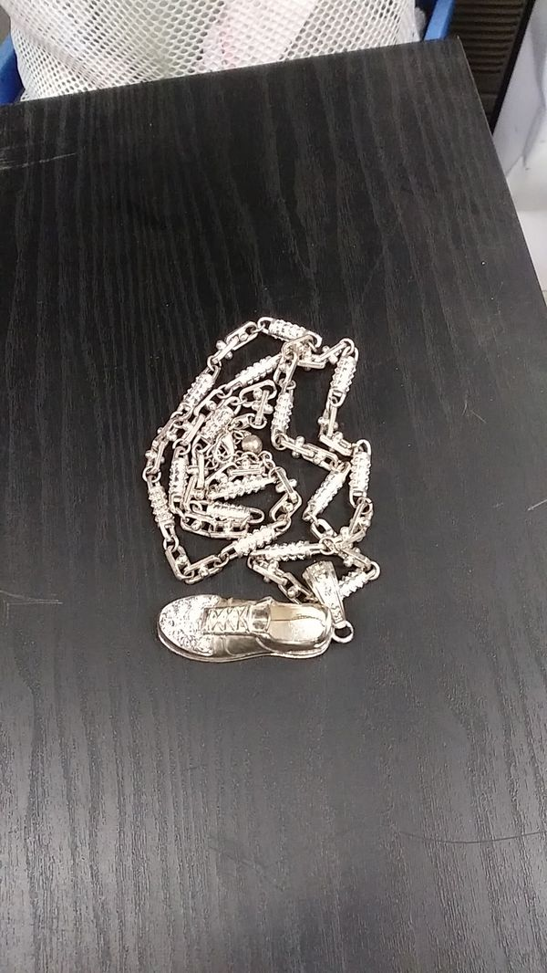 Silver chain with sneaker