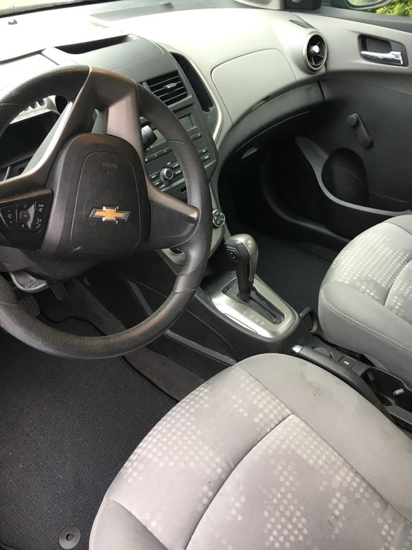 2014 Chevy sonic clean title excellent condition. Great gas mileage