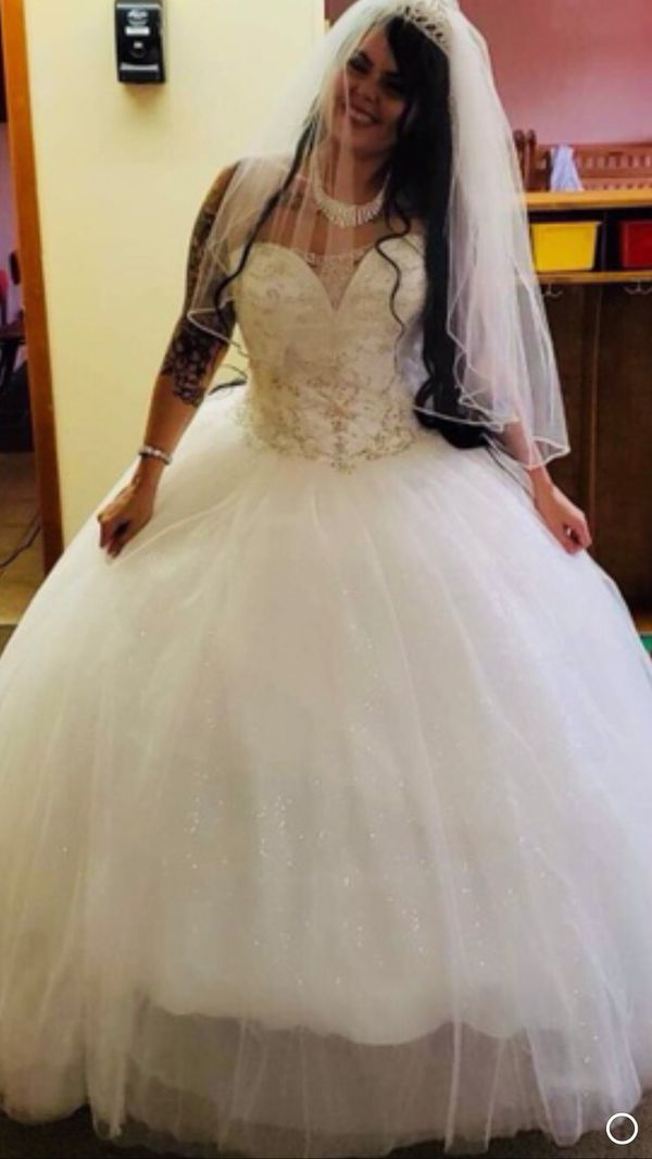 Size 14 wedding dress brand new bought in July