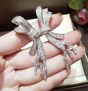 Cz diamond silver bow earrings for Sale in Austin, TX