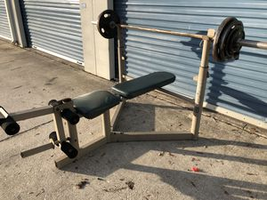 Olympic weight set bench bar weights for Sale in Oviedo, FL