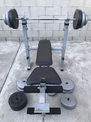 Bench press and weight plates for Sale in Alhambra, CA