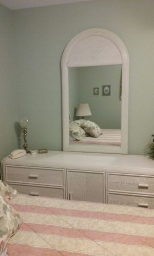 "Triple dresser with mirror in off-white with bamboo trim. Dresser is 6' L x 20""w x 29"" h. Mirror is 56"" h x 30"" w. Price is $200 for both pieces. for Sale in Prudenville, MI"