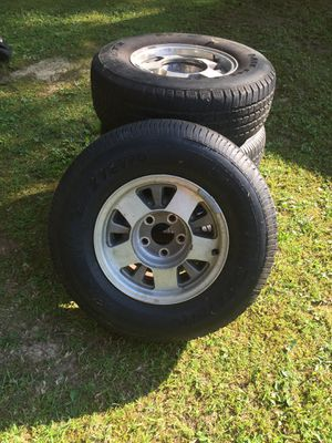 Dextero Tires and rims like new. Silverado original 235/75 R 15 for Sale in Gadsden, AL