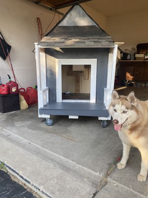 Durable, sturdy dog house with front porch, rear window, ventilation all around and painted with behr premium plus exterior weather resistant paint. for Sale in Grayslake, IL