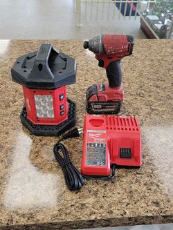 MILWAUKEE IMPACT DRILL MODEL#2753-20 & FLOOD LIGHT #2361-20 & BATTERY W/ CHARGER*14226* for Sale in Tacoma,  WA