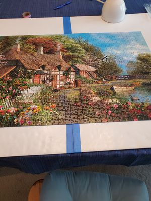 "Ravensburger 1000 pc jigsaw puzzle. ""Cottage on the Lake"". for Sale in Richmond, TX"