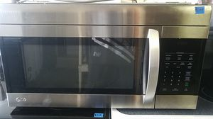 Stainless steel and black LG microwave for Sale in Tampa, FL