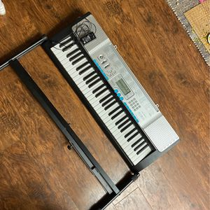 Casio LK-220 with cable and stand for Sale in Yorba Linda, CA