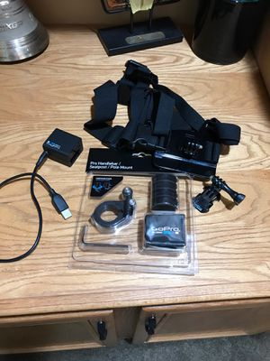 Gopro mounts + battery and battery charger for Sale in Corona, CA