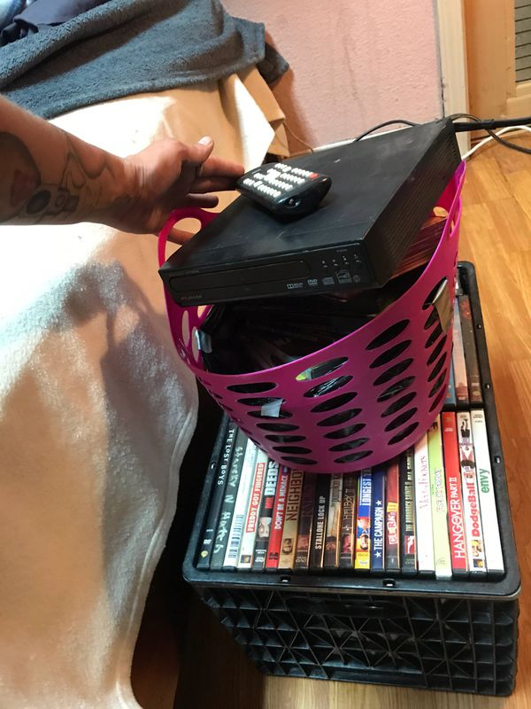 Dolby DVD player remote and 80 movies plus Cord