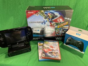 Nintendo Wii U 32gig deluxe console bundle rarely ever used! Includes both games (unopened) and 2nd controller for Sale in Seattle, WA