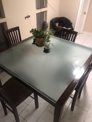 Check out this Glass and wood table kitchen and chairs I'm selling for $250 on OfferUp. for Sale in Las Vegas, NV