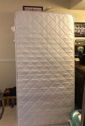 Twin mattress with protector for Sale in Boca Raton, FL