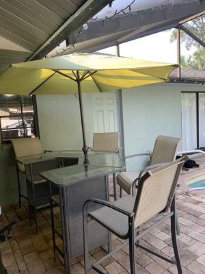 Bar with 4 High back stools shelves and umbrella 64 x 48 seat height each stool 29 inch stool seat for Sale in New Port Richey, FL